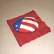 Rock painted red, white and blue to hold napkins down.