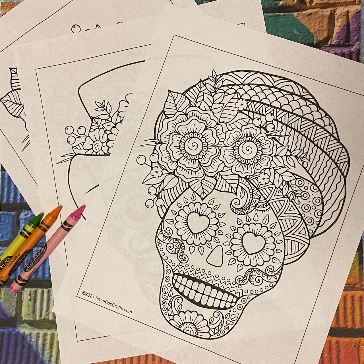 Coloring pages for older children featuring sugar skulls.