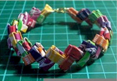 folded gum or candy wrappers made into a bracelet