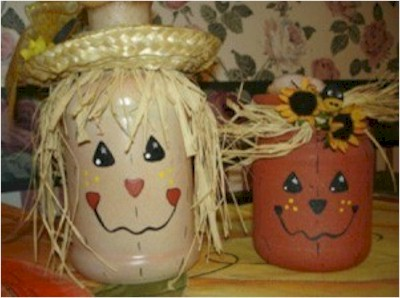 Decorative Scarecrow and pumpkin painted jars.